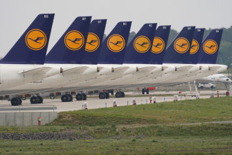 Passenger planes of German airliner Lufthansa stand parked and not in use at Willy Brandt Berlin Brandenburg International Airport