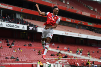 Pierre-Emerick Aubameyang of Arsenal celebrates after scoring his team's first goal during the Premier League match between Arsenal FC and Norwich City at Emirates Stadium.