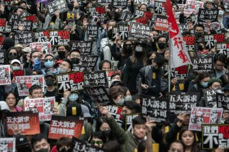 Tens of thousands of people march through the streets of the Causeway Bay district of Hong Kong on January 1.