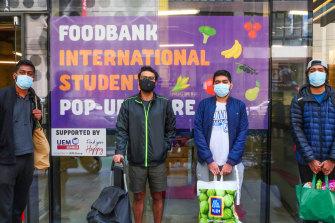Students Arum Kumar, Akar Gupta, Nitin Kumar and Shravan Kumar at the Aurora Melbourne Central Foodbank International Student Pop-Up Store.