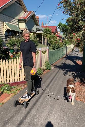 Harris walking her dog, Beans, around her neighbourhood.