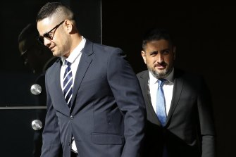 Jarryd Hayne and his lawyer Leo Premutico leave Newcastle Local Court.