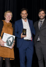 Wrong Skin consulting producer Siobhan McHugh and executive producer Greg Muller accept the award for Podcast of the Year from MC Tom Hogan.