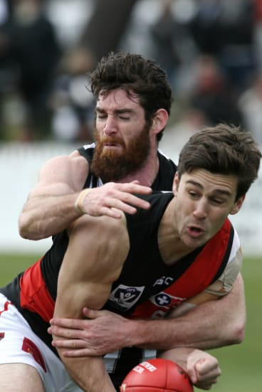 In the mix:  Tyson Goldsack tackles  Joe Harrison during Collingwood's 34-point loss to Essendon in the VFL elimination final.