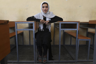 Sabzina Merzayee, 12, sits in a classroom in Shaidayee, near Herat in western Afghanistan, in June. Her family had to flee their home province of Ghor, to the east of Herat, after Sabzina's school was burnt down.