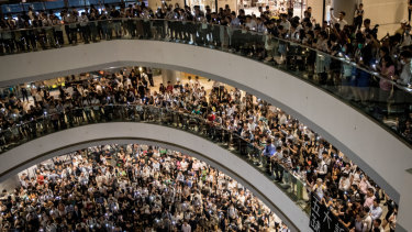 Protesters sing songs and shout slogans after gathering at the IFC Mall in Hong Kong on Thursday.