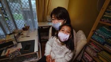 Sayaka Nakamoto with daughter Mira, 5, wearing their face masks at their home in Altona.