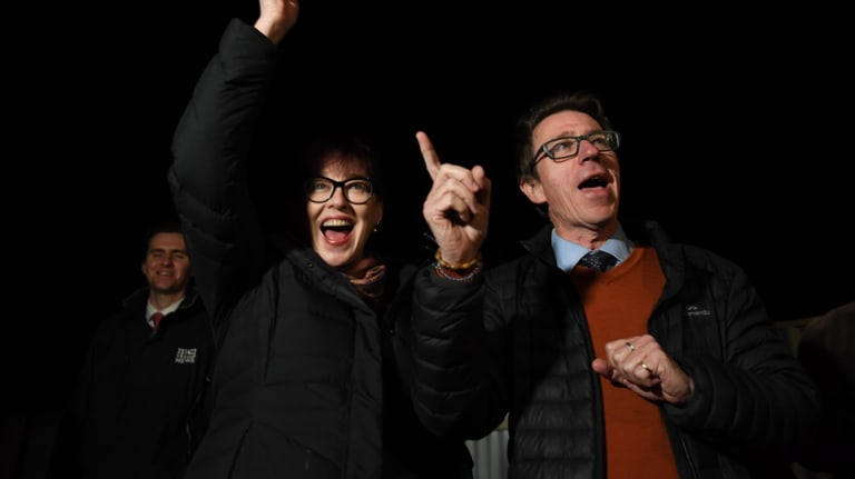 Joe McGirr and his wife, Kerin Fielding, celebrate as victory looked imminent in Wagga Wagga on Saturday.