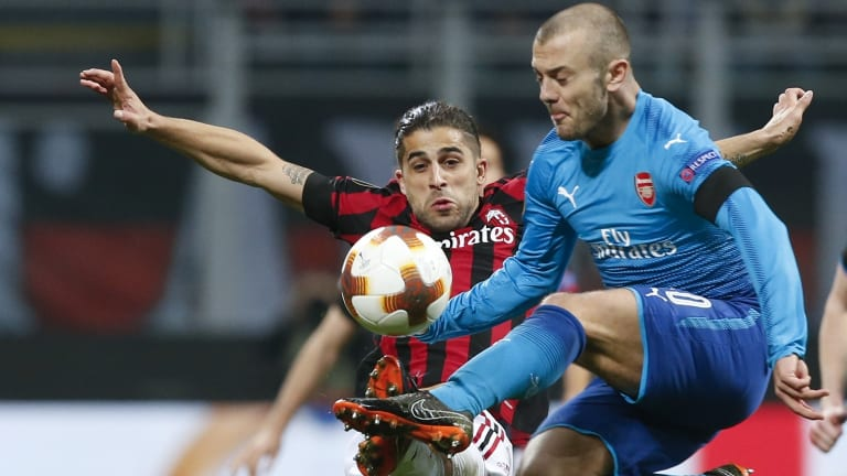 Arsenal's Jack Wilshere (right) and Milan's Ricardo Rodriguez.