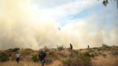 'A tough day out there': Fire crews remain in Yanchep battling 'dynamic' blaze