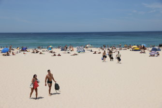 Beachgoers during a heat wave at Bondi Beach in Sydney on Saturday.