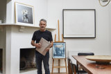 Carlo, an exhibiting artist for more than 30 years, in his light-filled dining room. His own work, Sleep, is on the mantel, a Geoff Nees papercut dominates the wall and, on the easel, is a collage by the late Hugh Kroll.