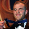 Mitchell, born to love football, takes home AFL's highest individual honour