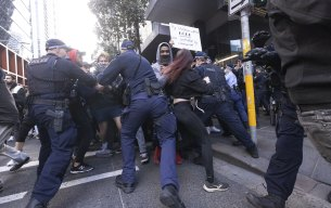Divided city reaches boiling point with anti-lockdown protest