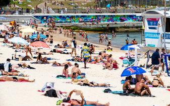 People flocked to Bondi Beach on Monday as Sydney sweltered through a heatwave.