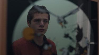 Toby Wallace as Erik Jensen.