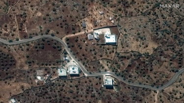 The reported residence of the late IS leader, Abu Bakr al-Baghdadi, in north-western Syria near the village of Barisha, top right.