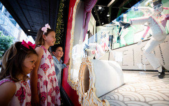 Siblings, Charlotte, 8, Louis, 5, and Amelia, 3, Smith looking at the David Jones Christmas windows in Sydney.