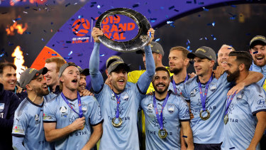 Sydney FC players celebrate after winning last year's A-League grand final.