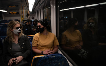 Passengers wear masks at Central on August 27.