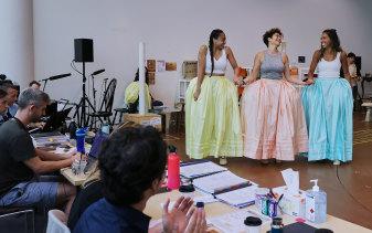 Work: Elandrah Eramiha, Akina Edmonds and Chloé Zuel rehearsing ahead of the opening night of the Australian production of Hamilton on March 27.