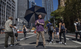 Damien MacRae wants to see more Australians protect themselves from the sun using an umbrella.