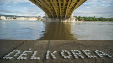 Candles make up the name of South Korea under the Margaret Bridge where a boat carrying South Korean tourists sank in Budapest, Hungary.