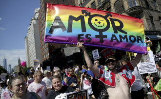 Marchers participate in the Queer Liberation March in New York on Sunday to mark the 50th anniversary of the Stonewall protests.