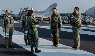 Taiwanese President Tsai Ing-wen speaks with military personnel on Wednesday as part of Taiwan's five-day Han Guang military exercise designed to prepare the island's forces for an attack by China.