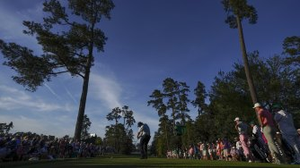 The beauty: Phil Mickelson drives at the 18th at Augusta National.