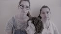 Hannah Forbes (right) and her sister Louise (left) pleaded with Brisbane dog owners to be vigilant, after their dog Harvey (middle) was poisoned in Teneriffe Park.