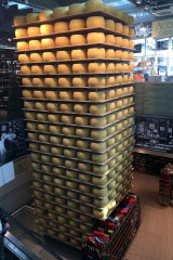 A tower of parmesan takes centre stage at a deli in Parma.
