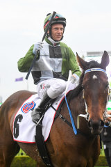 Brett Prebble returns to the mounting yard after the win by Incentivise.
