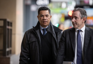 Simiona Tuteru (left) arrives at court on Tuesday with his lawyer David Hallowes.