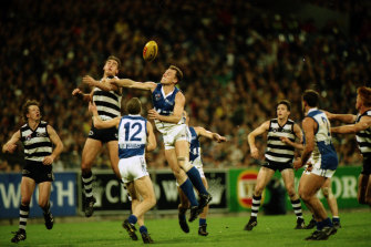 North and Geelong players jump for the ball.