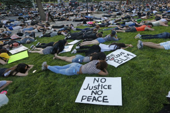 Protesters lie down for eight minutes and 46 seconds during a protest at the University of Utah.