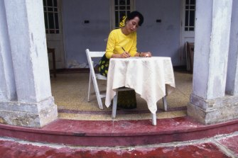 Suu Kyi under house arrest in her dilapidated mansion in Yangon (formerly Rangoon) in 1996.
