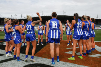North Melbourne celebrate their close semi-final win over Collingwood.