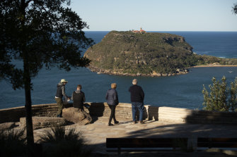 Soaring views: Visitors at West Head, in the Ku-Ring-Gai Chase National Park, look eastwards towards the Barrenjoey Lighthouse on Wednesday.
