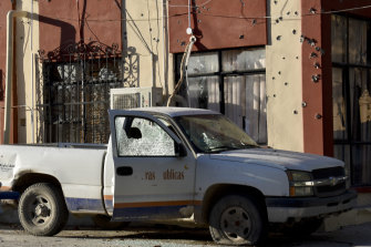 A damaged vehicle is parked at the City Hall of Villa Union, Mexico, on Saturday.