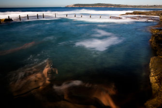 Swimmers at Mahon Pool in Maroubra on a warm autumn morning.