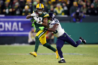 Green Bay's Davante Adams, left, is tackled.