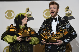 Billie Eilish, left, and Finneas O'Connell with all their Grammys.