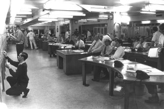 Herald reporters watch as election results are posted in the newsroom in the early '70s.