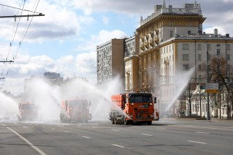 Tankers spray disinfectant on the empty Garden Ring in Moscow on Sunday.