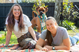 Loz Robinson and Emily Hallam from Melbourne's Glen Iris adopted 14-month-old boxer Cooper in July.