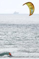 """I love it"": 19-year-old kitesurfer James Carew practises at Torquay on Sunday."