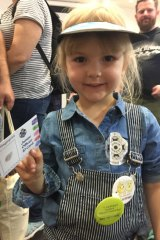 Eloise Nye, from Wynnum at the police exhibit with her junior officer passport.
