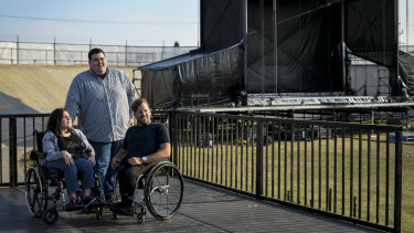 Paralympian and tennis star Dylan Alcott (right), pictured with Sarah McDonald and her brother Daniel, has created a music festival for music lovers with disabilities.