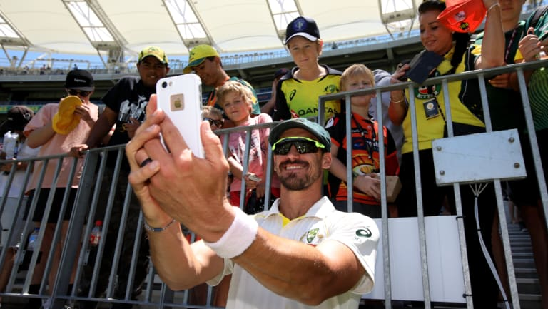 Smile: Mitchell Starc takes a selfie with young fans after Tuesday's clinical finish in Perth.